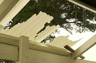 The roof of a house in Port Waikato was ripped off today
