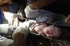 Firefighters and doctors work to free the baby from the sewer pipe (Reuters)