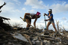 Oklahoma residents work to clean up the aftermath of the May 20 tornado (Reuters)