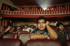 Ram Pratap Verma, a 32-year-old aspiring Bollywood film actor, watches a film at a cinema in Mumbai (Reuters)
