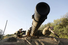 Israeli soldiers clean a tank near the border with Syria  (Reuters)