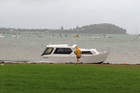 The boat Kingfish washed ashore in Okahu Bay, Auckland today (Photo: Felicity Boucher/iWitness)