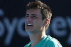 The father of Australian tennis player Bernard Tomic has been charged with assaulting his son's hitting partner after allegedly headbutting Thomas Drouet (Reuters)