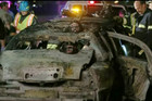 Emergency services workers inspect the burnt-out wreckage of a limousine which caught fire in San Francisco killing five