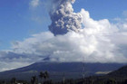 Ash rises after an eruption of Mayon Volcano in Legazpi city in central Philippines