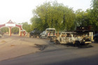 Military vehicles approach the entrance of the Shehu's Palace of Bama in Nigeria. 