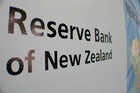 Graeme Wheeler told MPs the bank had sold Kiwi dollars last month to drive down the currency
