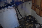 The charred remains of the Samsung top-loading washing machine are all that is left