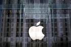 The Apple logo hangs inside the glass entrance to the Apple Store on 5th Avenue in New York City (Reuters)