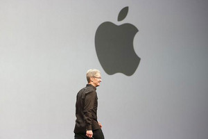 Apple Chief Executive Tim Cook takes the stage during the Apple WWDC (Reuters)