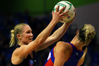 Magic's Laura Langman swings the ball at Mystics' Julie Corletto (Photosport)