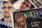 Edward Snowden and US President Barack Obama in newspapers (Reuters)