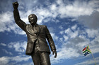 A statue of Nelson Mandela stands outside the gates of Drakenstein Correctional Centre (Reuters)