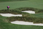 Sergio Garcia looks for his ball at Merion (Reuters file)