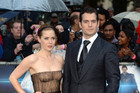 Henry Cavill with co-star Amy Adams braved the rain (AAP)