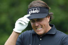 Mickelson returned from his daughter's eighth-grade graduation about 3½ hours before his tee time (Reuters)