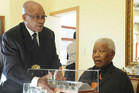 South African president Jacob Zuma presents Nelson Mandela with a gift in 2011 (Reuters)