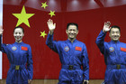 Chinese astronauts wave before leaving on their space journey (Reuters)