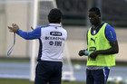 Italy's coach Cesare Prandelli (L) talks to Italy's national soccer player Mario Balotelli (Reuters file)