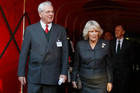 Sir Chips Keswick (left) with The Duchess of Cornwall at Arsenal's Emirates Stadium (AAP file)