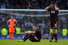 Hearts' players (R-L) John Sutton, Danny Wilson and Jamie MacDonald (Reuters file)