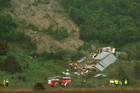 A woman is dead after a house collapsed in a landslide in Marahau northwest of Nelson