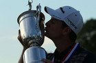 Justin Rose kisses the trophy after his US Open win (Reuters)