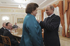 Vladimir Putin (R) decorates Valentina Tereshkova (Reuters)