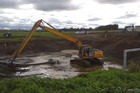 Police dredge an effluent pond on the Guy family farm in Fielding (NZ Police)
