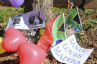 Balloons and posters have been laid outside Pretoria hospital (Reuters)