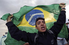 A demonstrator with the Brazilian flag protests against the Confederation's Cup