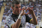 Gareth Bale's goal celebration is a heart-shaped hand gesture he dedicates to his long-time girlfriend (Reuters)