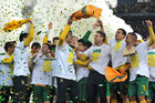 Socceroos players celebrate booking their place at the 2014 World Cup after a 1-0 win over Iraq (AAP)