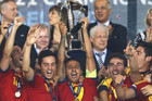 Spain captain Thiago Alcantara holds aloft the European Under-21 trophy after their 4-2 win over Italy (Reuters)