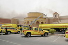 Firefighters outside the Villagio Mall on May 28, 2012 (Reuters)