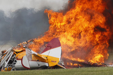 The plane tilts and crashes to the ground, erupting into flames as spectators screamed