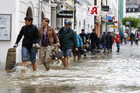 People walk through the flooded centre of the Bavarian town of Passau (Reuters)