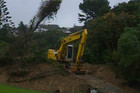 Diggers are poised to help clean up the slips