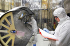 Technicians work on the payload fairing that will protect NASA's Interface Region Imaging Spectrograph (Reuters)