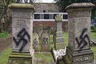 The men drew swastikas on Jewish graves