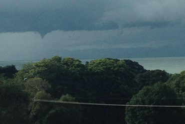Water spouts before touching water in the middle of the firth of Thames, viewed from Waharau Regional Park (Johnson Goodlet)