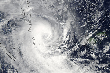 Tropical Cyclone Lusi slams Vanuatu, seen in the top left of the image (NASA)
