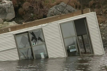 A building blown into water in Greymouth