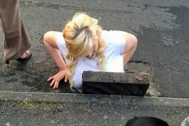 A teenage girl stuck trying to rescue her phone