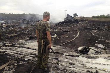 An armed pro-Russian separatist stands at a site of a Malaysia Airlines Boeing 777 plane crash (Reuters)